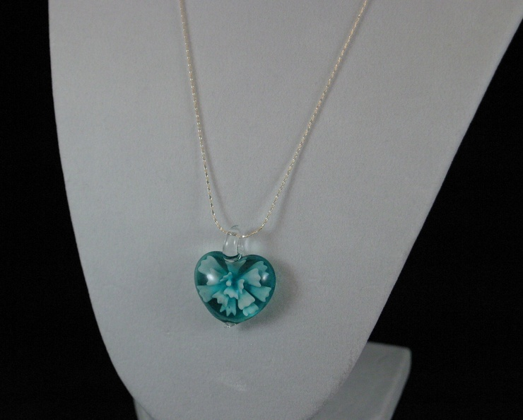 Aqua and white flower on Silver strand