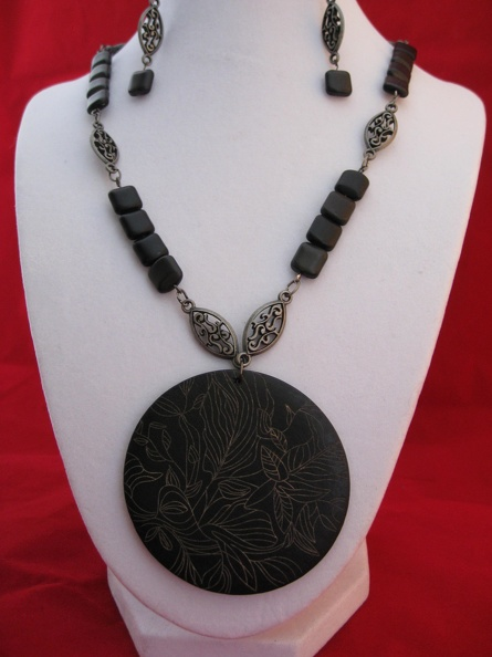 Etched wooden pendant.JPG