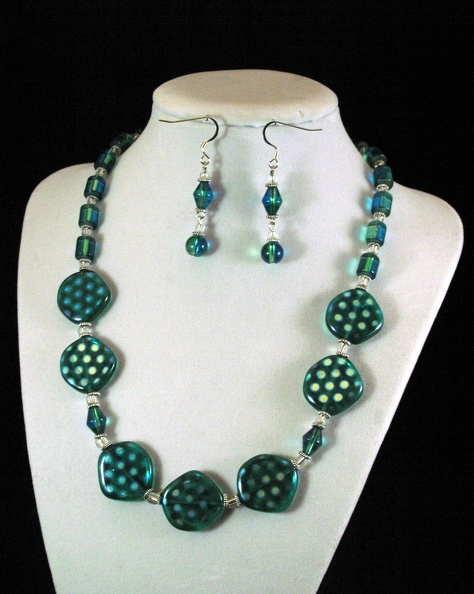 Silver Polkadots on Teal.jpg