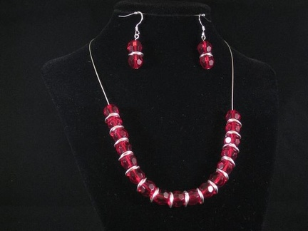 "Red crystals and silver rings - 17"" with 3"" extention"